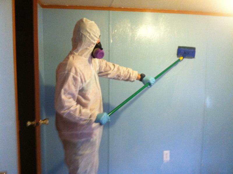 Affordable Cleanup LLC cleaning walls in a meth house in WV